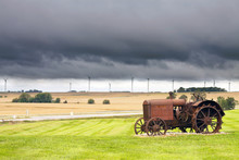Old Rusty Tractor With Storm W...