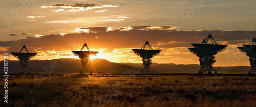 Fotografía  Very Large Array as Sunset (Satellite Dishes from Contact)
