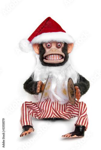 Foto op Plexiglas Aap Vintage mechanical monkey toy with santa hat and beard