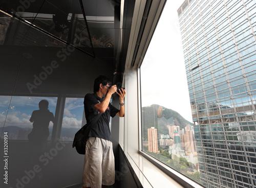 man on observation deck in Hong Kong Wallpaper Mural