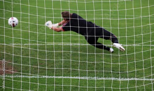 Photo  Soccer football goalkeeper making diving save