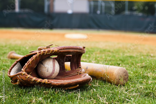 Fotografia, Obraz  Old Baseball, Glove, and Bat on Field