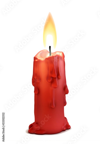 Fotografía  burning candle isolated over white