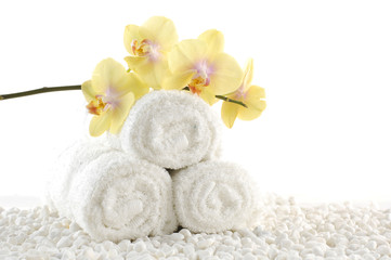 Obraz na płótnie Canvas Orchids on White spa towels on white pebble
