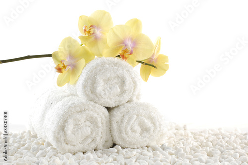 Fototapety, obrazy: Orchids on White spa towels on white pebble