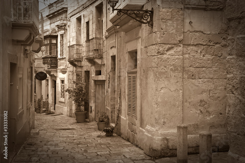 Retro photo of old narrow  street - 33331082