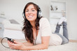 Good looking brunette woman listening to music with her mp3 play