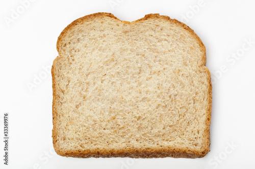 Fényképezés A slice of whole wheat bread