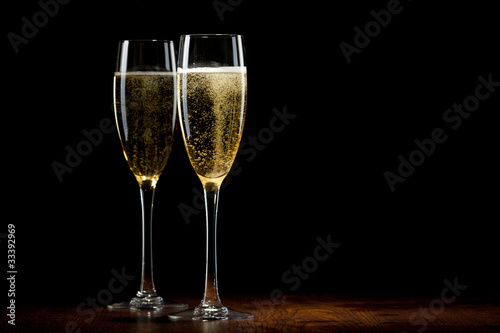 Valokuvatapetti two glass with champagne on a wooden table