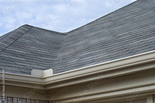 Fotografie, Obraz  Rain Gutters Splash Guard on Roof against blue sky