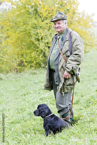 Foto op Canvas Jacht hunter with his dog hunting