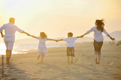 Juliste  happy young family have fun on beach