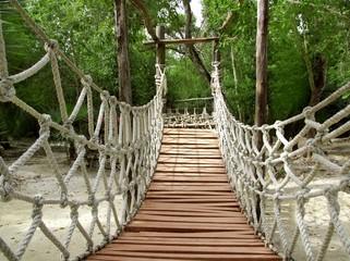 Fototapeta Do pokoju młodzieżowego Adventure wooden rope jungle suspension bridge