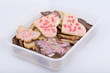 studio-shot of a food storage box full with cookies.