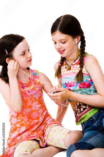 Fototapeta Happy girls listening MP3 obraz na płótnie