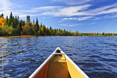 Canoe bow on lake Fototapet