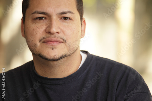 Fotografie, Obraz  Headshot of a young Latino man