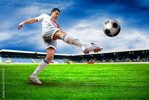 Foto op Aluminium Voetbal Happiness football player after goal on the field of stadium wit