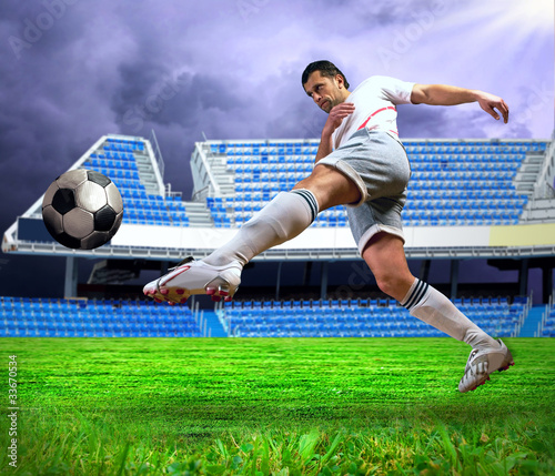 Fotobehang Voetbal Happiness football player after goal on the field of stadium und