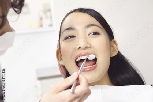 Fotografia  歯科検診を受ける女性
