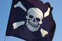 Jolly Roger Flag On A Blue Sky Background