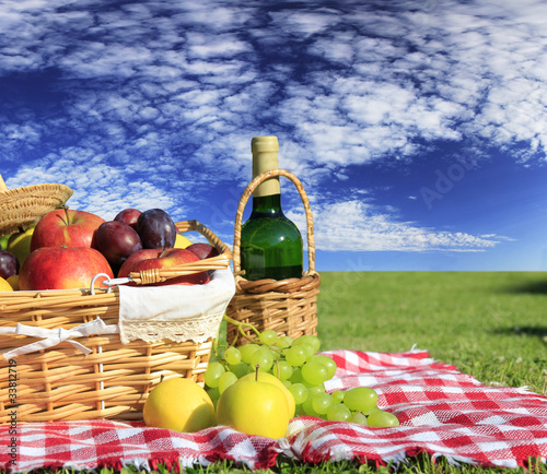 Spoed Foto op Canvas Picknick Picnic at meadow with perfect sky background