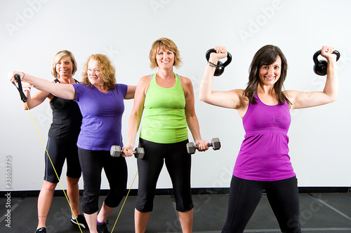 Fotografie, Obraz  Group of women working out at a gym