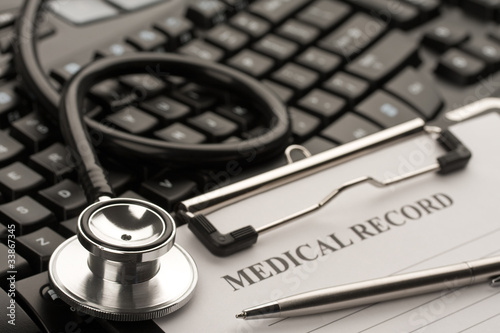 Fotografie, Obraz  Doctor's stethoscope and medical record on computer keyboard