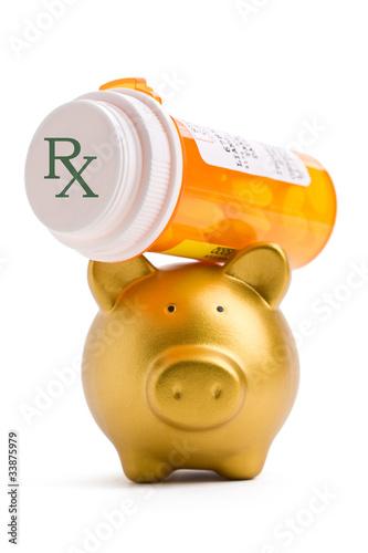 Fotografie, Obraz  Piggy bank lifting a prescription medicine bottle on white