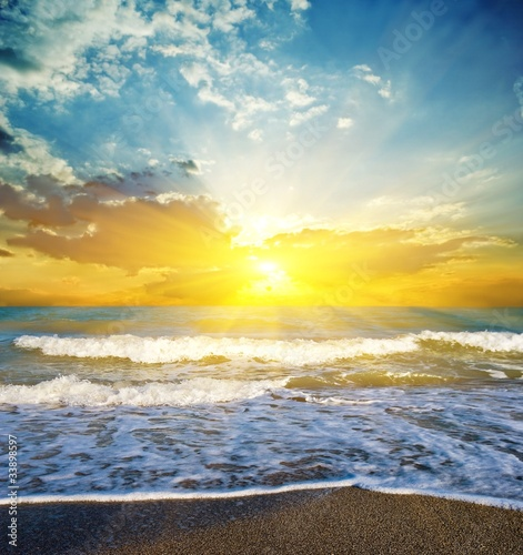 Staande foto Strand dramatic sunset on a seacoast