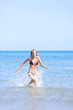 Woman running in the sea