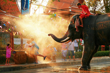 Elephant spraying water on people during Songkran festival, Bangkok
