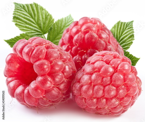 Poster Fruit Three perfect ripe raspberries with leaves.