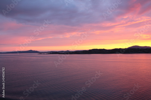 Keuken foto achterwand Lavendel sunset view from a boat off the coast of norway