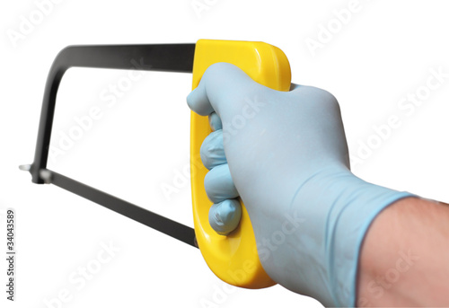 Men's gloved hand holding a hacksaw Canvas-taulu