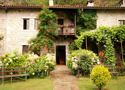 Colorful rural house with garden #34046168