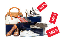 Shoes With Sale Tags And Handbag On Boxes