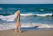 Young beautiful blonde girl in bikini with pareo on the sunny t