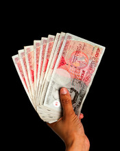 Money Held In Hand - UK Currency With Clipping Path - Black BG