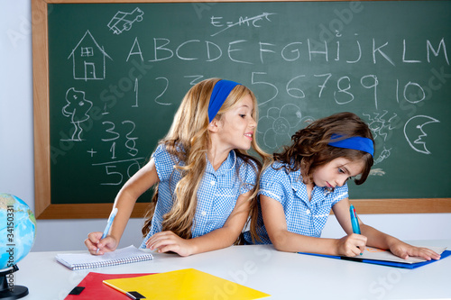 Foto classroom with two kids students cheating on test