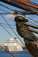 Old Ships Figurehead With Modern Cruiseliner In The Background.