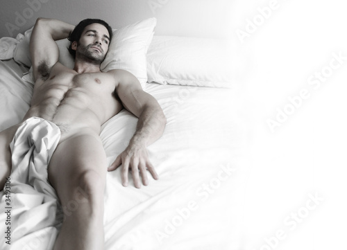 Photo  Sexy hunk in bed