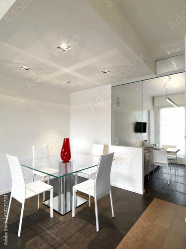 sala da pranzo con tavolo quadrato e vista sulla cucina – kaufen Sie ...