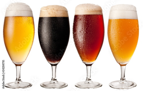 Four glasses with different beers Canvas Print