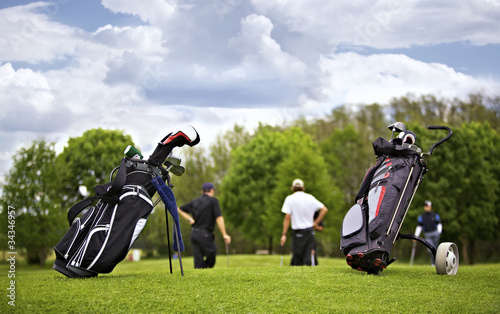 Deurstickers Golf Golf bags with group of players