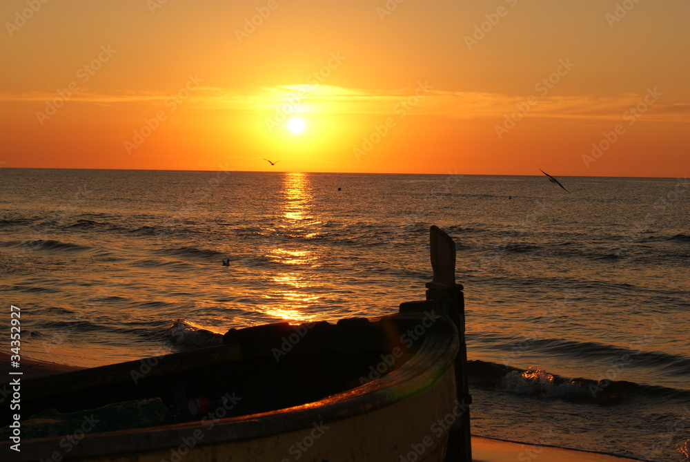 The sunset and a boat