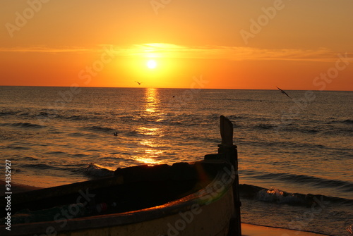 The sunset and a boat - 34352927
