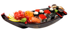 Set Of Sushi On Wooden Stand In The Form Of The Boat