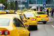 Yellow taxi cabs waiting in front of airport terminal