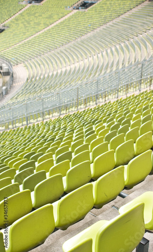 plakat Empty plastic seats at stadium, open door sports arena
